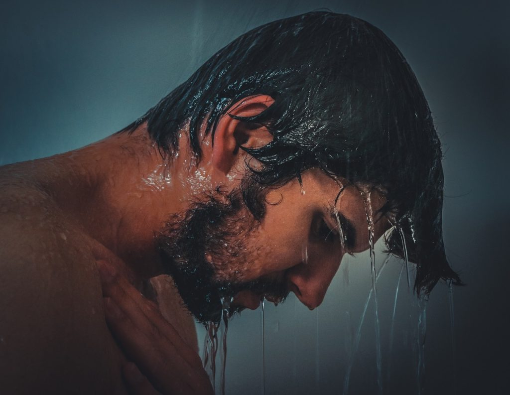 Showering man (closeup)