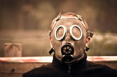 Young boy in a gas mask