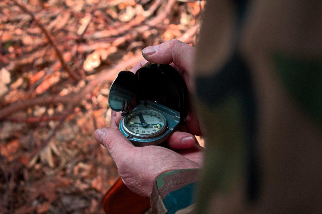 Compass in man's hand (closeup)