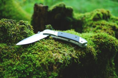 Closeup of a folding knife on a rock