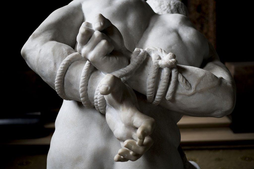 Sculpture of a bound man