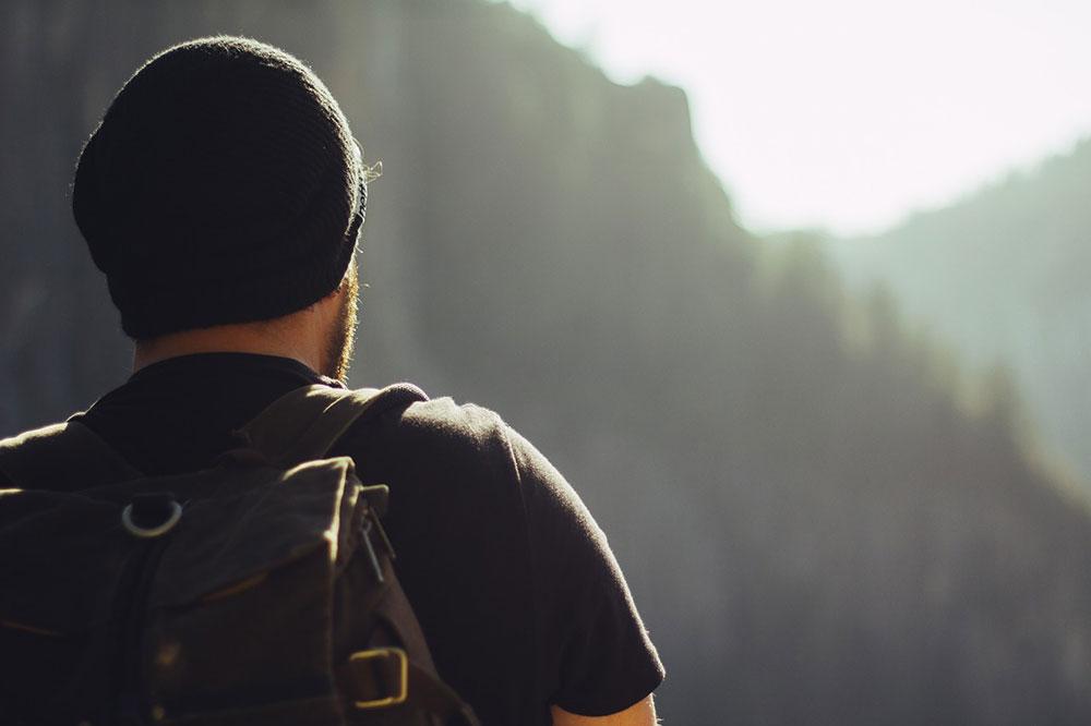 Hiking man from behind (closeup)