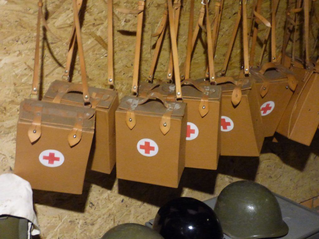 Vintage first aid kits in a bunker